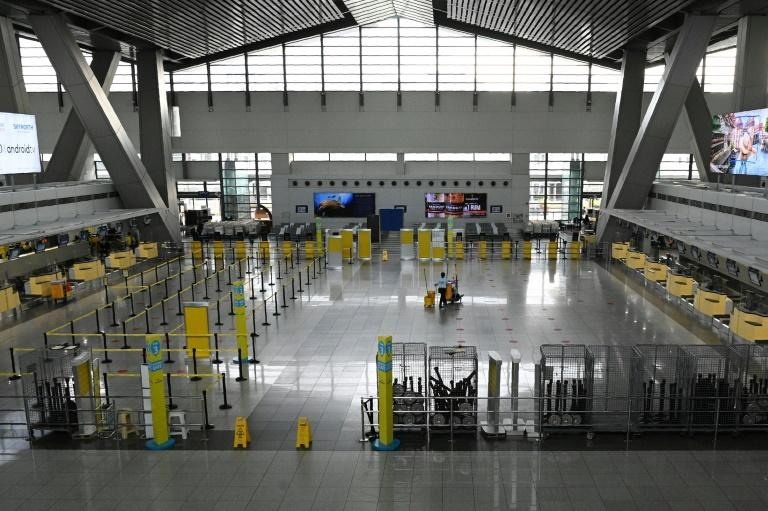 The reimposition of quarantine measures in the Philippines at short notice left many workers stranded (AFP Photo/Ted ALJIBE)