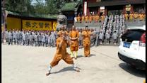 Shaolin monk pulls SUV with his ear