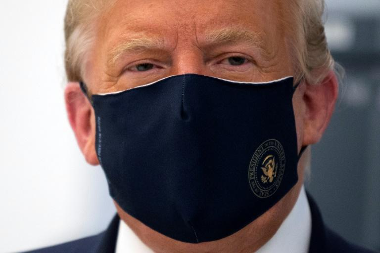 US President Donald Trump is back to promoting conspiracy theories about the coronavirus crisis (AFP Photo/JIM WATSON)