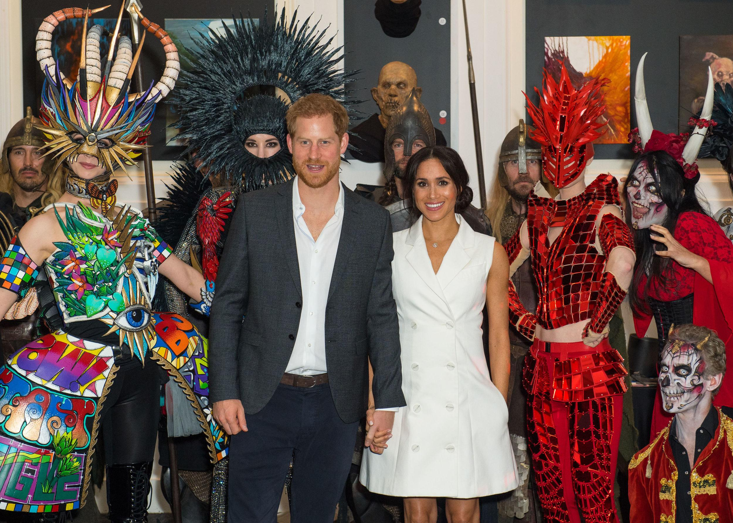The Duke and Duchess of Sussex pose for a photo with actors in costume during a visit to Courtenay Creative, in Wellington, on day two of the royal couple's tour of New Zealand.