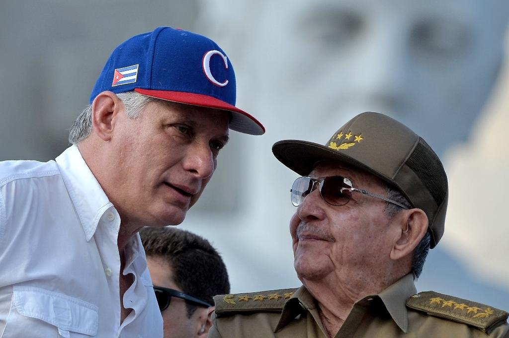 Cuban President Miguel Diaz-Canel (L), seen here with former president Raul Castro during a May Day rally in Havana, is visiting Venezuela on his first foreign trip as president