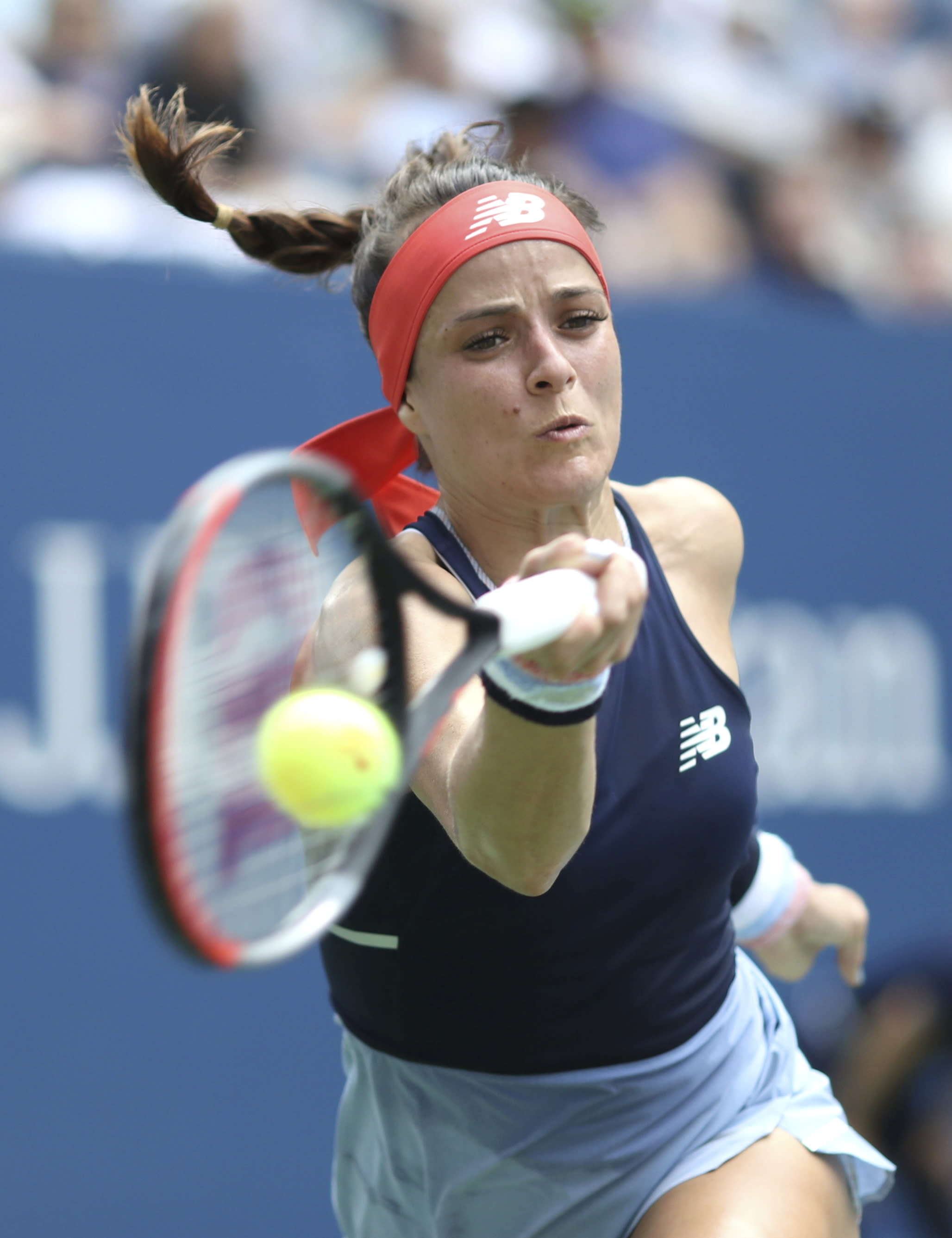 Nicole Gibbs, of the United States, returns a shot to Simona Halep, of Romania, during the first round of the US Open tennis tournament Tuesday, Aug. 27, 2019, in New York. (AP Photo/Kevin Hagen)