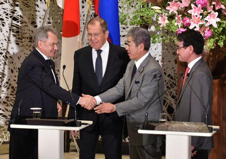 Russian Foreign Minister Sergei Lavrov and Defence Minister Sergei Shoigu attend their joint news conference with Japanese Foreign Minister Taro Kono and Defense Minister Takeshi Iwaya after their two-plus-two Foreign and Defense Ministers meeting between Japan and Russia at the Iikura Guest House in Tokyo, Japan, May 30, 2019. Kazuhiro Nogi/Pool via Reuters