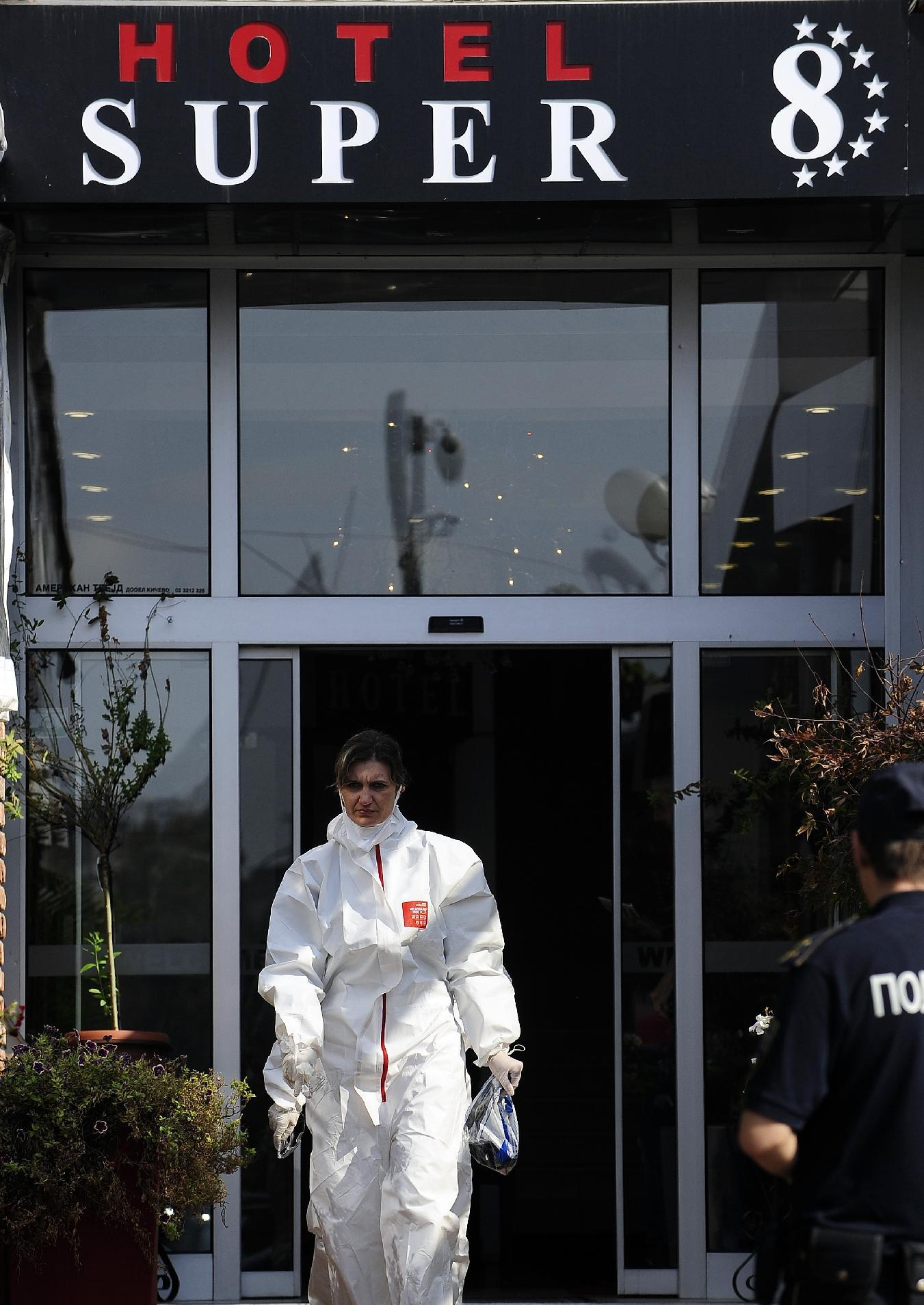 Medical staff exit the Super 8 hotel after visiting quarantined guests and personnel following the death of a British man who allegedly displayed Ebola-like symptoms, in Skopje on October 10, 2014 (AFP Photo/Robert Atanasovski)