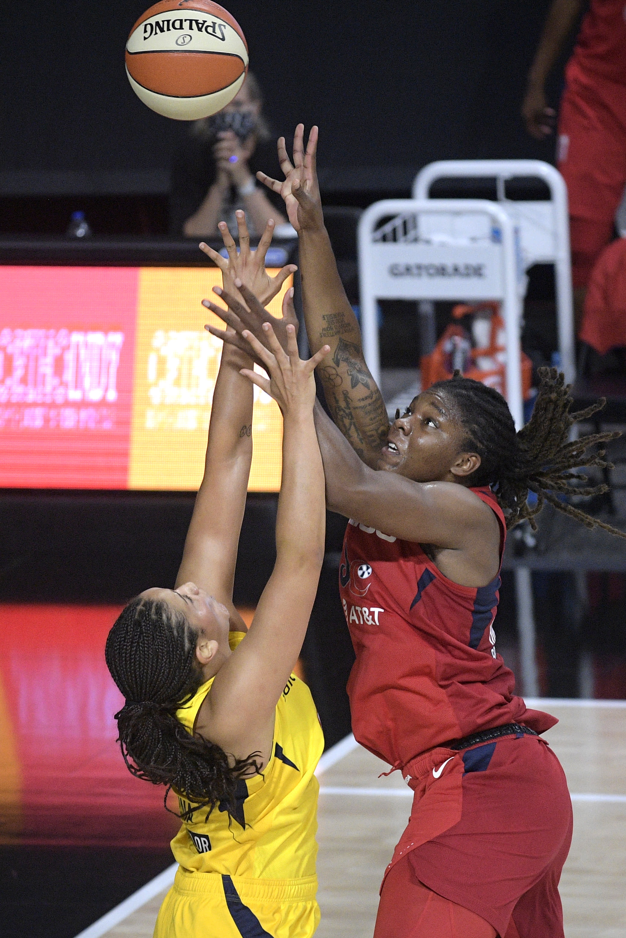Washington Mystics forward Myisha Hines-Allen, right goes up to shoot in front of Indiana Fever forward Natalie Achonwa during the first half of a WNBA basketball game, Saturday, July 25, 2020, in Ellenton, Fla. (AP Photo/Phelan M. Ebenhack)