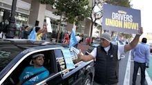 California Governor Signs Law That Could Upend Uber, Lyft