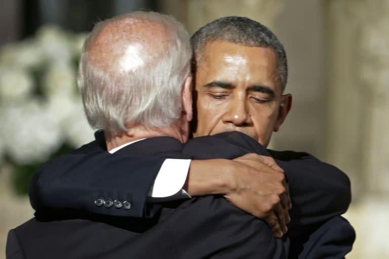 US President Barack Obama and Vice President Joe Biden at the funeral service for Biden's son Beau (AFP Photo/PABLO MARTINEZ MONSIVAIS)