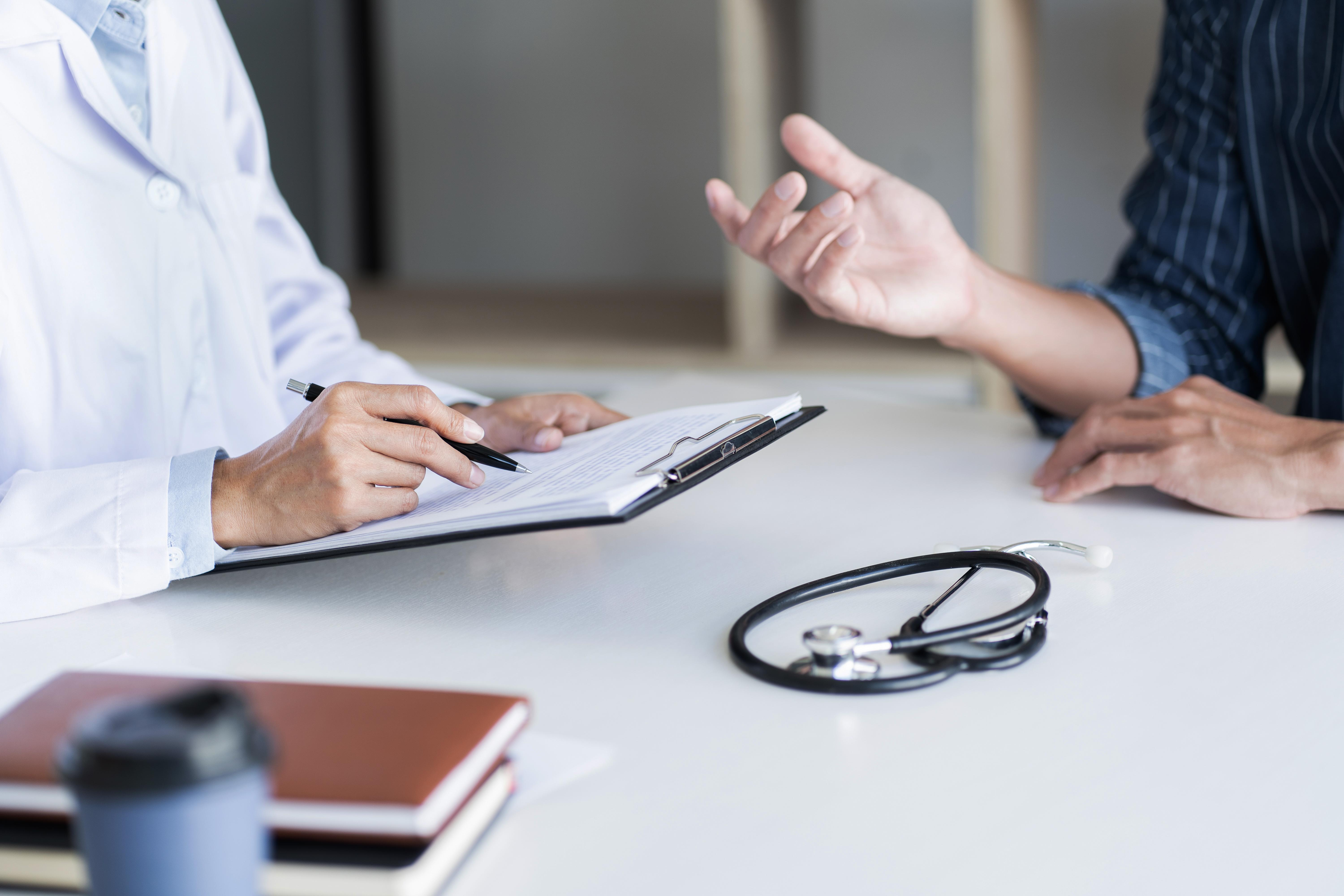 Doctor with patient in medical clinic or hospital.