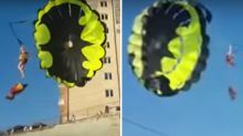 Out of control parasail plunges young couple into power lines