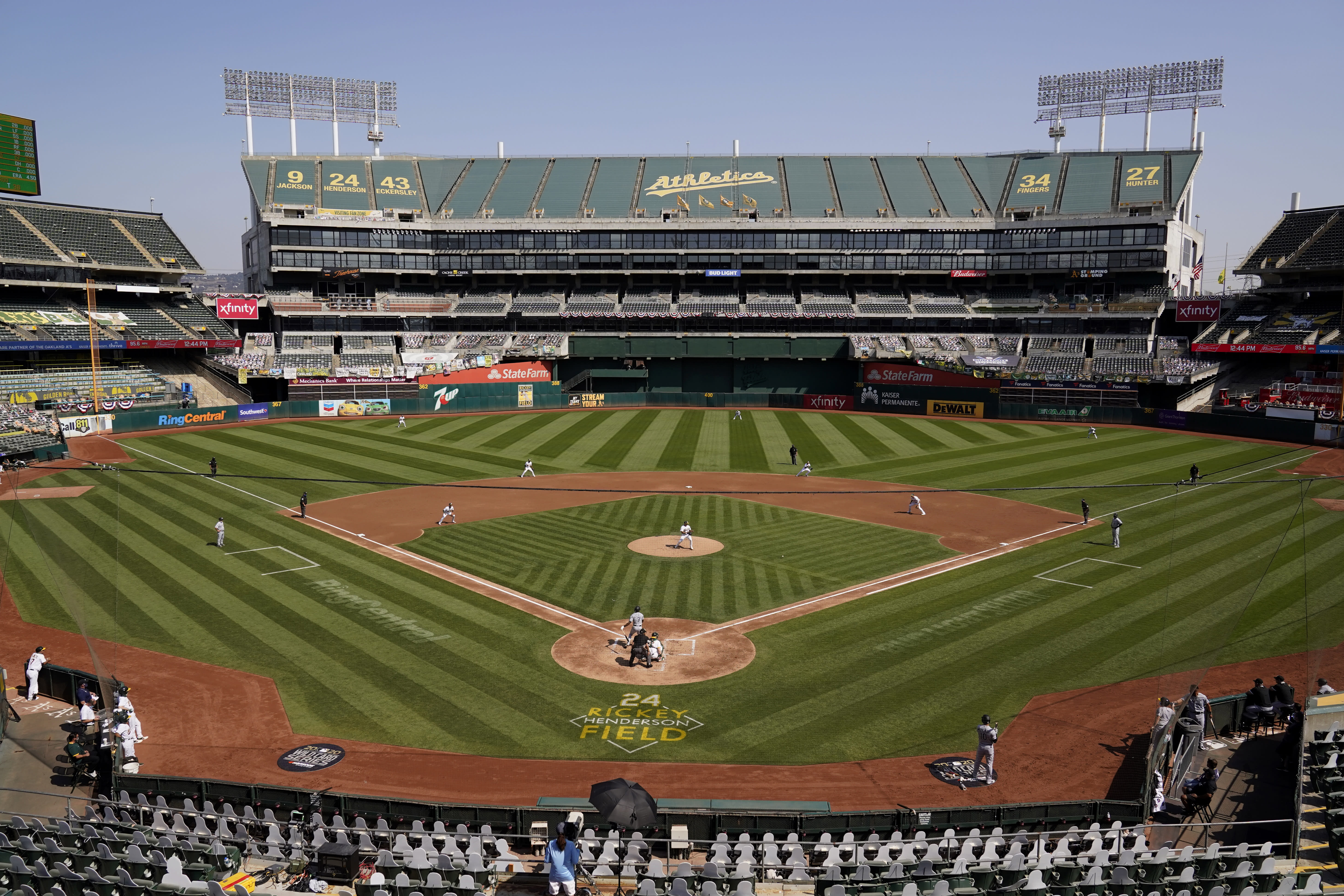 Chicago White Sox's Tim Anderson hits a single off of Oakland Athletics' Jesus Luzardo as seen from a general view of Oakland Coliseum during the third inning of Game 1 of an American League wild-card baseball series Tuesday, Sept. 29, 2020, in Oakland, Calif. (AP Photo/Eric Risberg)