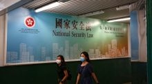 Shocked Hong Kong in a new era under 'white knuckle' China grip