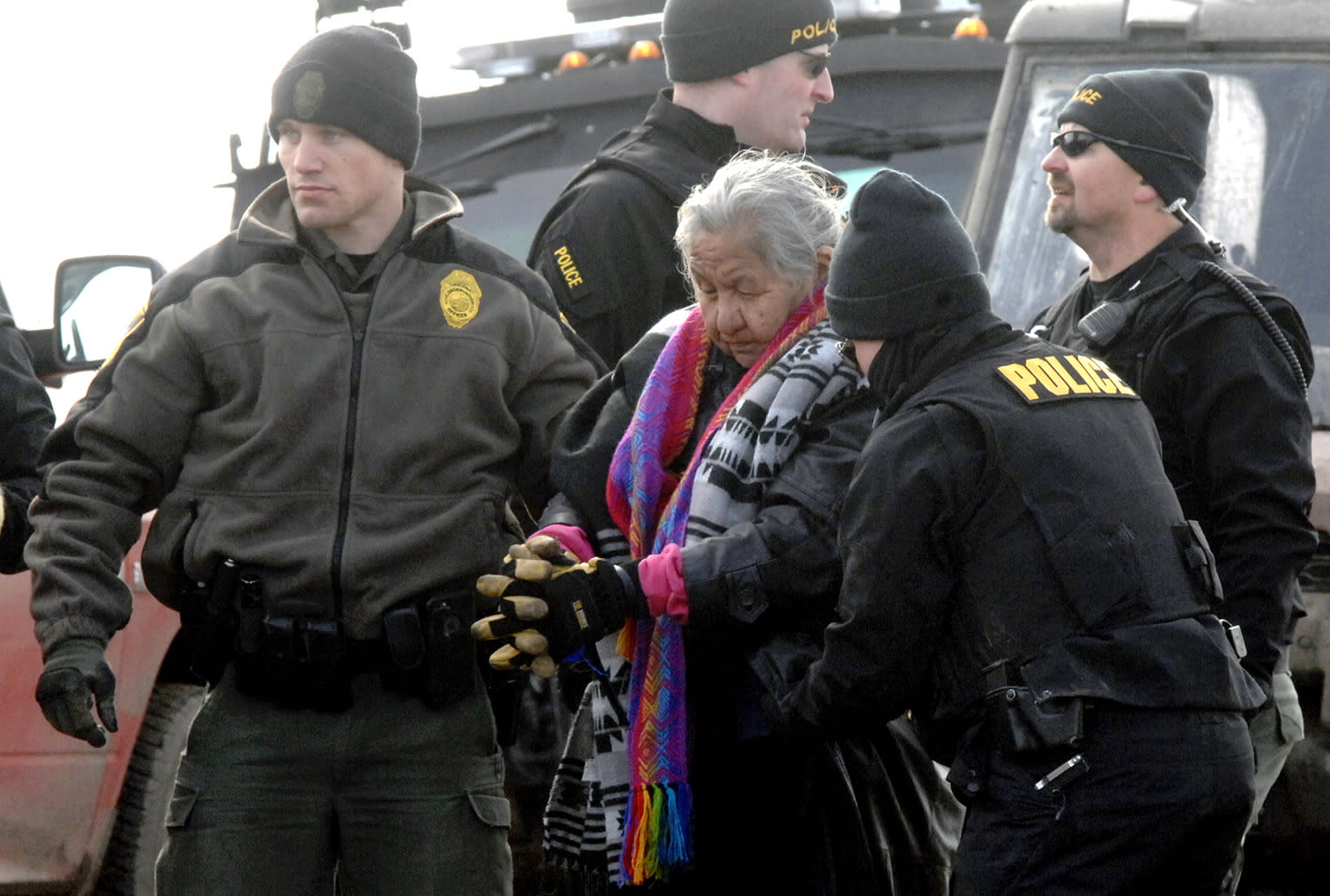 <p>An elderly woman is escorted to a transport van after being arrested by law enforcement at the Oceti Sakowin camp as part of the final sweep of the Dakota Access pipeline protesters in Morton County, Thursday, Feb. 23, 2017, near Cannon Ball, N.D. (Mike McCleary/The Bismarck Tribune via AP, Pool) </p>