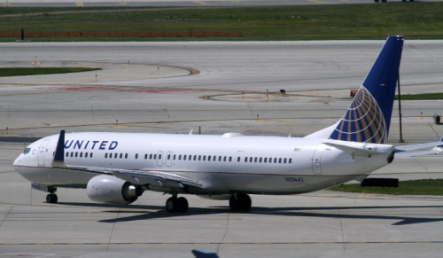 A United Airlines plane with the Continental Airlines logo on its tail, taxis to the runway at O'Hare International airport in Chicago
