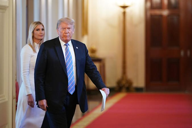 US President Donald Trump and his daughter Advisor Ivanka Trump arrive for an American Workforce Policy Advisory Board Meeting in the East Room of the White House in Washington, DC on June 26, 2020. (Photo by MANDEL NGAN / AFP) (Photo by MANDEL NGAN/AFP via Getty Images)