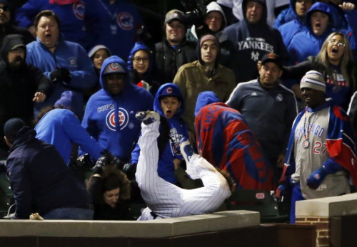 Chicago Cubs left fielder Kyle Schwarber catches a fly ball by New York Yankees' Chase Headley in foul territory during the 12th inning of an interleague baseball game Sunday, May 7, 2017 in Chicago. (AP Photo/Nam Y. Huh)