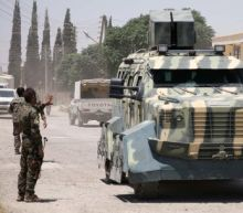 U.S.-backed Syrian groups take Raqqa district from Islamic State
