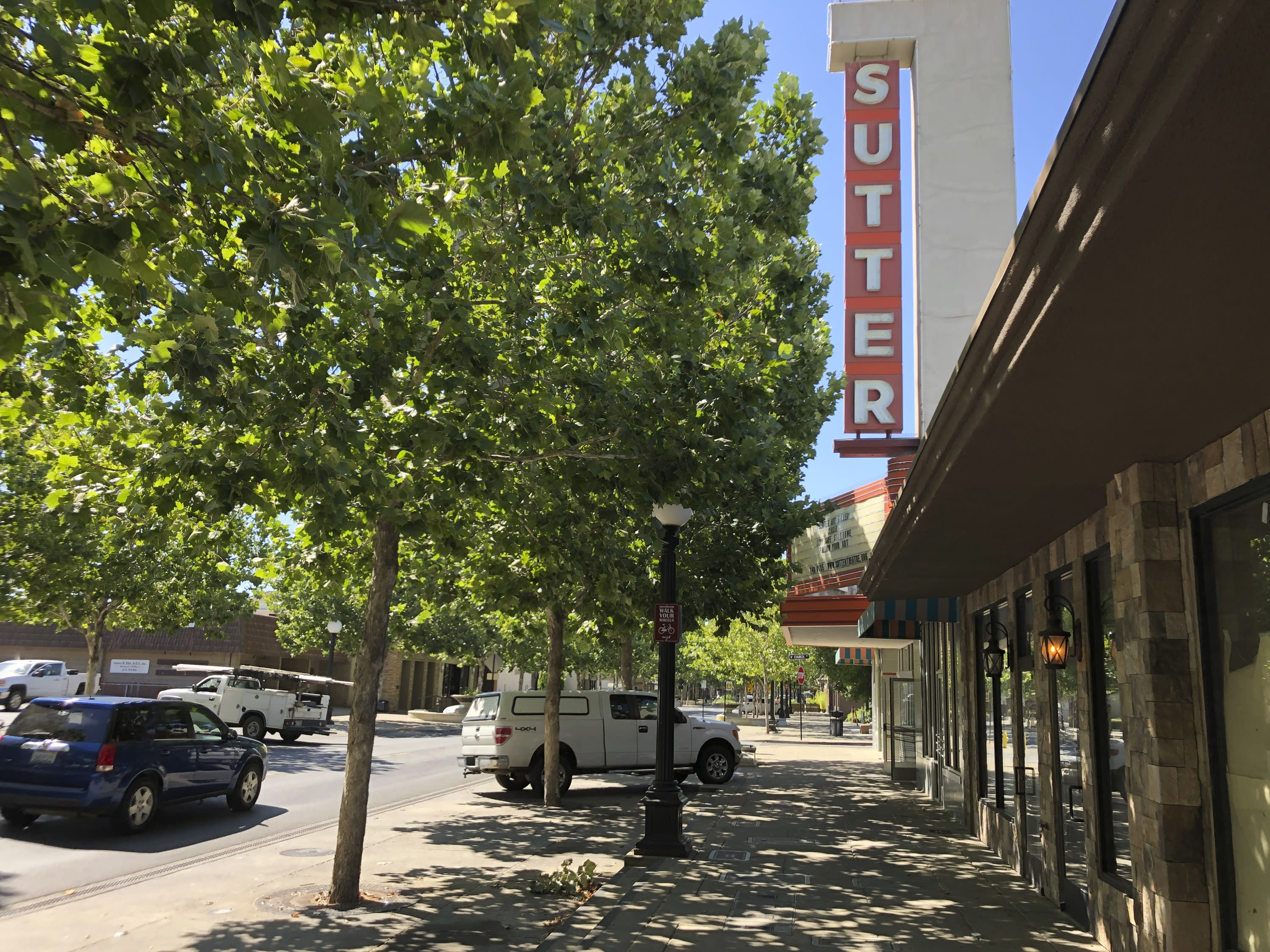 The Sutter Theater is seen on Plumas Street in Yuba City, Calif., Thursday, July 9, 2020. Sutter County was one of the first counties to reopen its economy when it defied Gov. Gavin Newsom's stay-at-home order in May to allow restaurants, hair salons, gyms and shopping malls to reopen. But Thursday, the county was added to a state watch list because of its rising number of coronavirus cases and hospitalizations. That will eventually trigger another round of restrictions, forcing bars to close and indoor operations to cease at restaurants and other public places for three weeks. (AP Photo/Adam Beam)