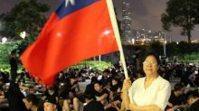 Many in Hong Kong, fearful of China's grasp, flee to Taiwan