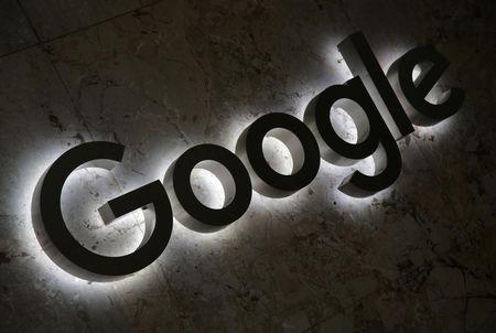 FILE PHOTO: A Google logo is displayed at the entrance to the internet-based company's offices in Toronto, Ontario, Canada, September 9, 2018. REUTERS/Chris Helgren/File Photo