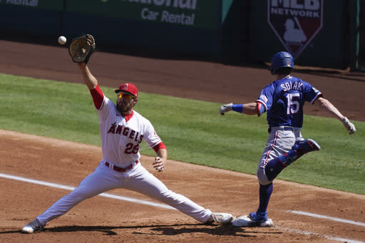Texas Rangers' Nick Solak (15) is safe at first base before a catch by Los Angeles Angels' Jared Walsh (25) during the second inning of a baseball game Monday, Sept. 21, 2020, in Anaheim, Calif. (AP Photo/Ashley Landis)