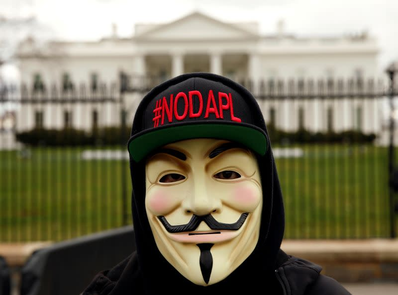 FILE PHOTO: Activist protests the Dakota Access and Keystone XL pipelines at the White House in Washington