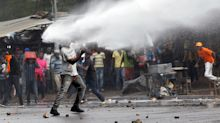 Supporters of opposition leader Raila Odinga clash with police in Nairobi, Kenya