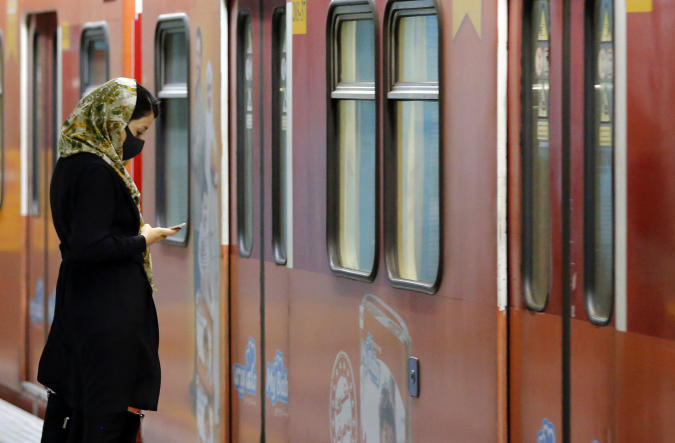 An Iranian woman wearing a face mask waits for a train carriage at a metro station in the capital Tehran on June 10, 2020 amid the coronavirus Covid-19 pandemic crisis. - Nearly one in five Iranians may have been infected with the novel coronavirus since the country's outbreak started in February, a health official said yesterday. The figure represents 18.75 percent of the more than 80 million population of Iran, which on June 9 announced another 74 deaths from the coronavirus. (Photo by STRINGER / AFP) (Photo by STRINGER/AFP via Getty Images)