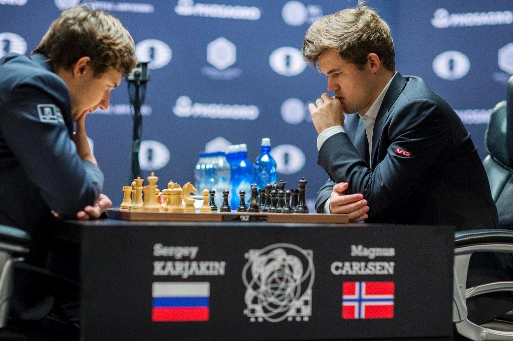 Magnus Carlsen, (R) Norwegian chess grandmaster and current World Chess Champion, and Sergey Karjakin, Russian chess grandmaster contemplate their moves during First of two tie-break rounds of the World Chess Championship on November 30, 2016