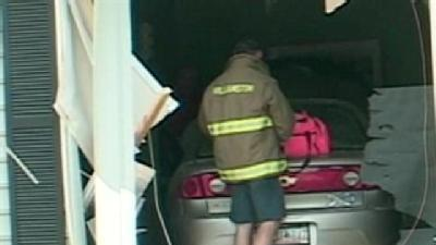 Car Crashes Into Building, Injures 10