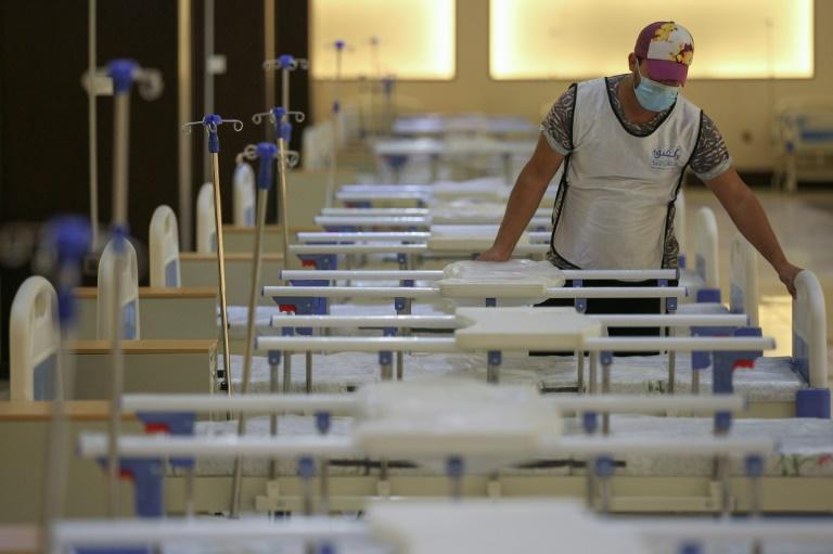 An Iraqi volunteer works on building a 525-bed field hospital at a Baghdad exhibition centre in June to help fight the coronavirus outbreak (AFP Photo/AHMAD AL-RUBAYE)