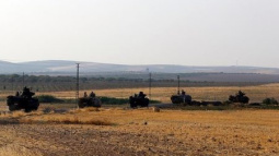 Turkish army pounds north Syria, monitor says 20 civilians killed