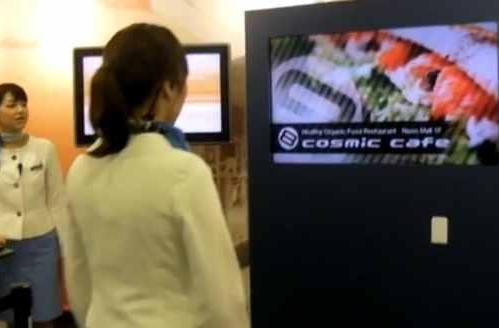 NTT's next-gen digital kiosk selects appropriate content with webcam, razzmatazz