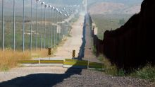 Exhibit showcases images of Mexico border walls, fences
