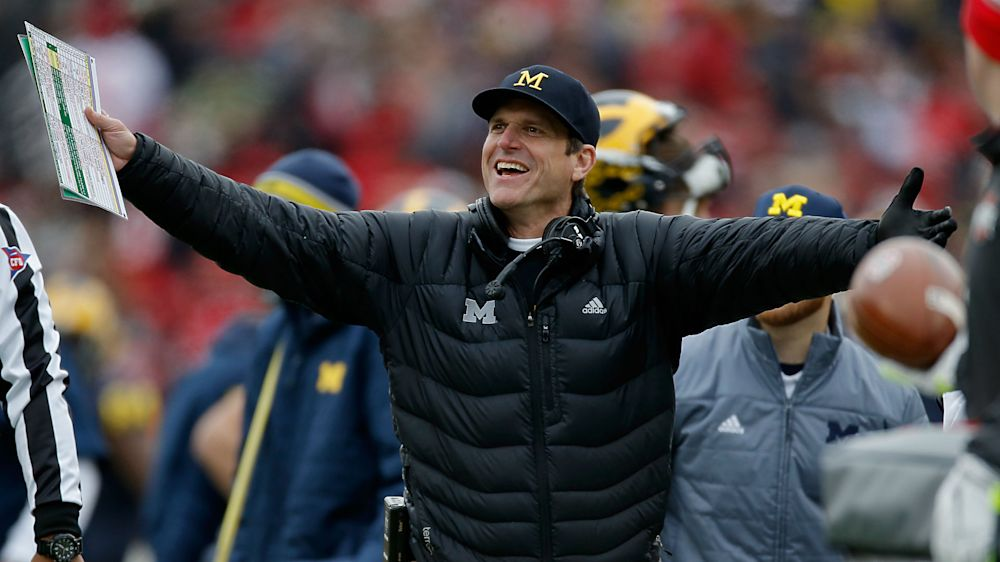 Nigerian refugee asks Michigan's Jim Harbaugh why sport is called 'football'