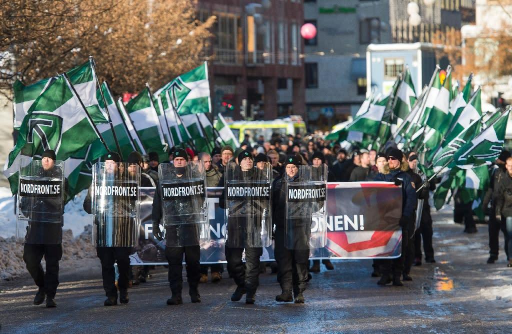 Members of the neo-nazi Nordic Resistance Movement (Nordiska motstandsrorelsens) demonstrate in central Stockholm against migrants (AFP Photo/Jonathan Nackstrand)