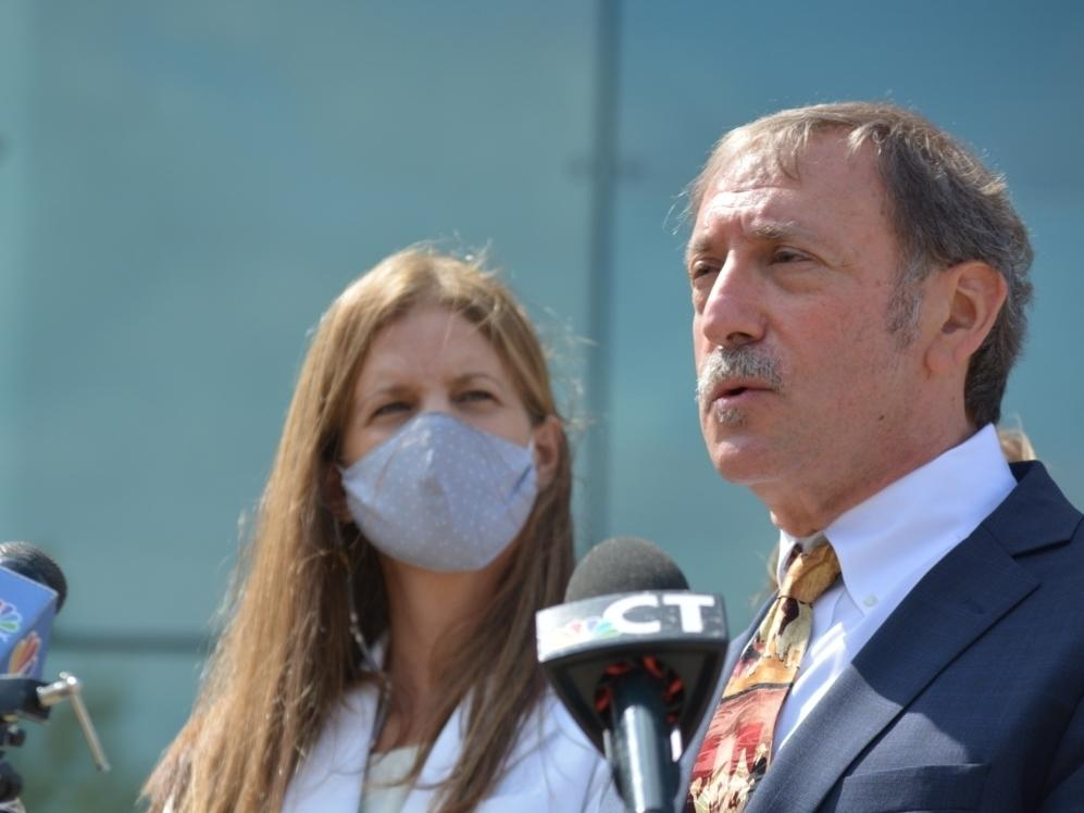 Michelle Troconis, left, and attorney Jon Schoenhorn after an August court hearing in Stamford.