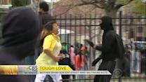 Angry mom grabs son off street amid Baltimore riot