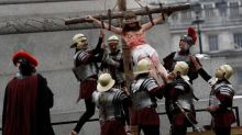 Hundreds descend on Trafalgar Square for gory re-enactment of Jesus's crucifixion