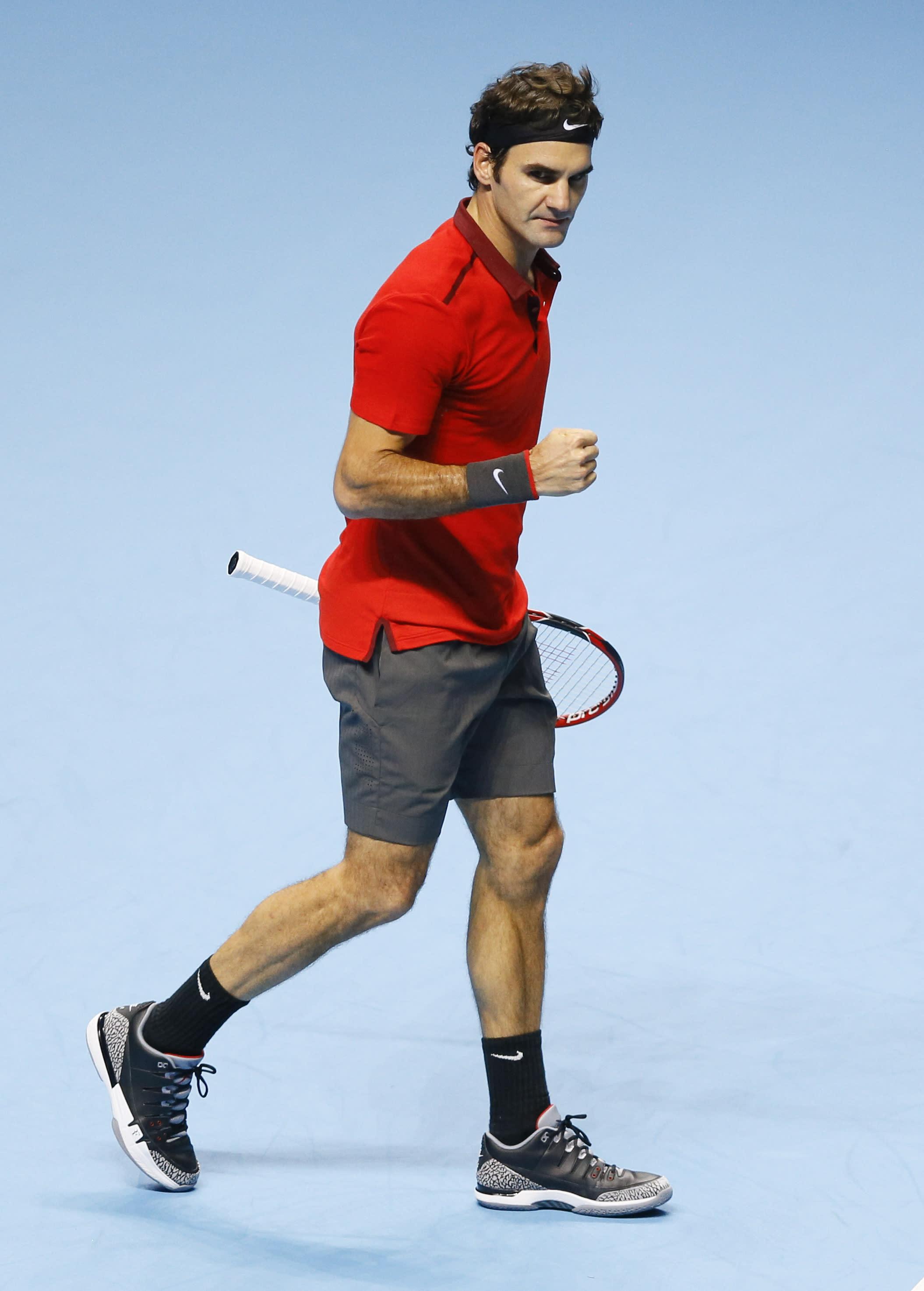 Federer, Nishikori win at ATP Finals