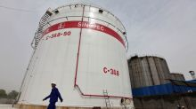 China's Sinopec, teapot oil refiners slash Feb output as virus hits demand - sources