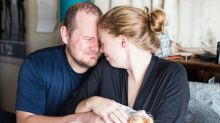 This couple's hilarious 'birthing' photo shoot might make you doubt cat owners' sanity