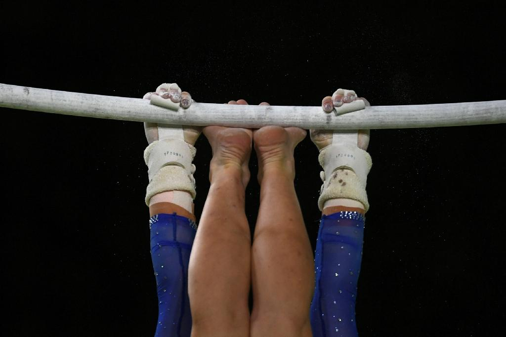 Gymnastics global president said a new helpine to report abuse would act as a deterrent to potential abusers and he expects the number of calls to shrink as time goes by
