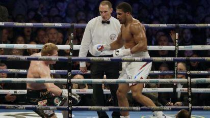 Joshua retains heavyweight crowns with KO