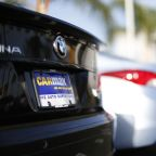 CarMax teams up with Dunkin' to lure more customers into test-driving cars