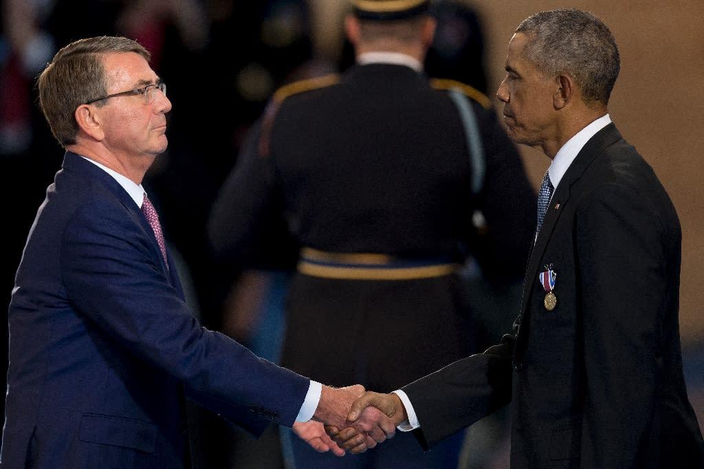 "Mattis's predecessor Ash Carter (L), the last defense secretary of US President Barack Obama (R), said the decision would ""send the wrong signal"" (AFP Photo/JIM WATSON)"