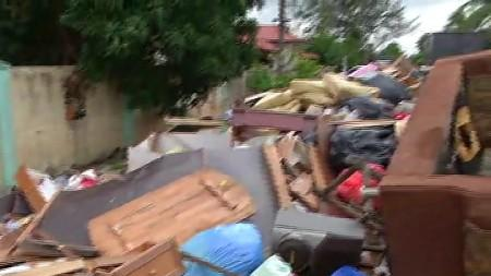 MONSOON FLOODS:HOME OWNERS RETURN TO BEGIN MASSIVE CLEAN-UP