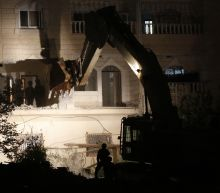 Israel destroys family apartments of accused Palestinian killer