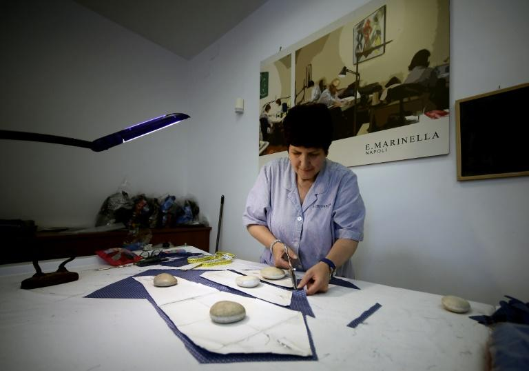 Each Marinella tie takes about 45 minutes to make, with ten steps in all, from cutting the silk to doing the stitching, and adding the loop and label (AFP Photo/FILIPPO MONTEFORTE)