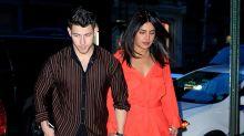 Priyanka Chopra Wears Orange Dress and Knee Brace For Date With Nick Jonas
