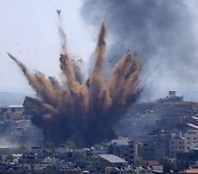 Israel begins firing shells into Gaza as fighting escalates